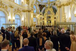 Guests listening to the concert given by the Urbi et Orbi chamber choir in the Great Church of the Winter Palace